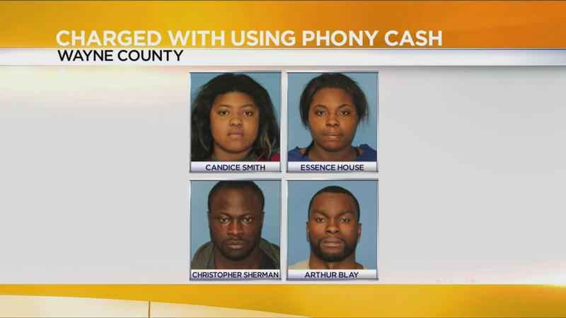 4 people charged with using phony cash in Wayne County