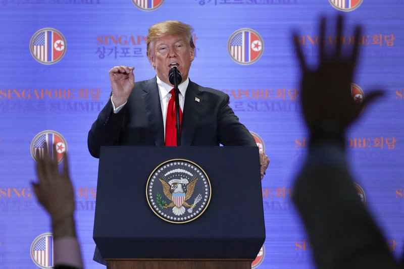 U.S. President Donald Trump answers questions about the summit with North Korea leader Kim Jong Un during a press conference at the Capella resort on Sentosa Island Tuesday, June 12, 2018 in Singapore