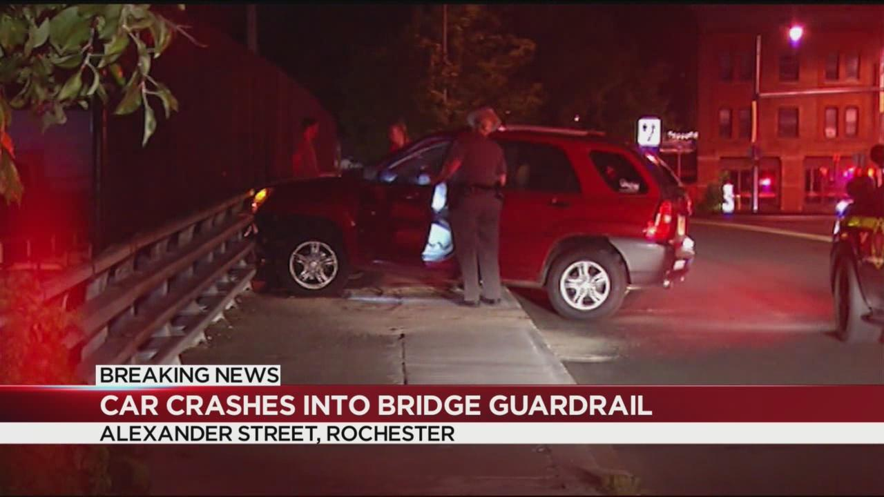 Police investigating after car crashes into bridge guardrail