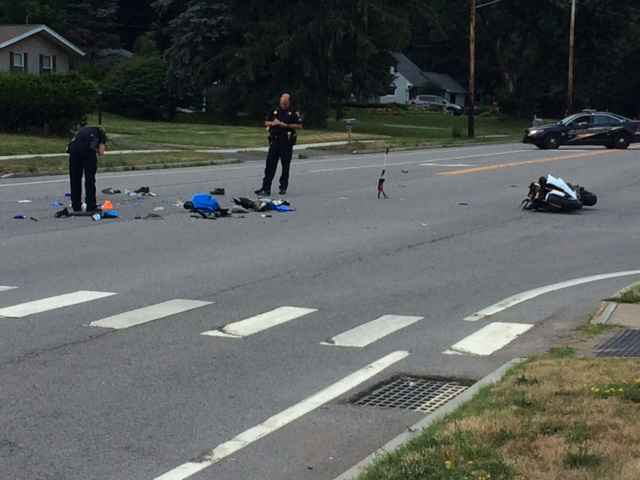 2 seriously injured after motorcycle strikes vehicle in Penfield