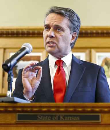 Kansas governor questions opponent's role in vote counting