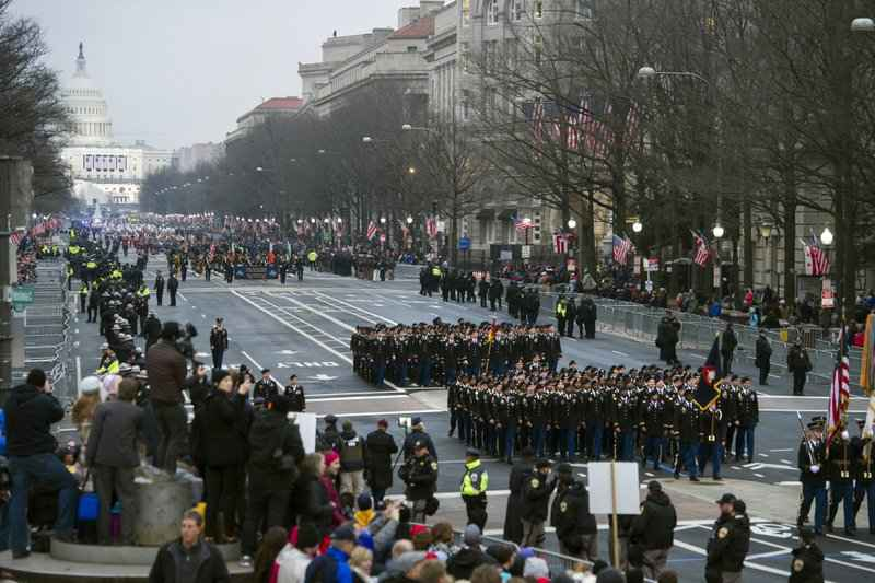 Military units participate in the inaugural parade from the Capitol to the White House in Washington, Friday, Jan. 20, 2017.