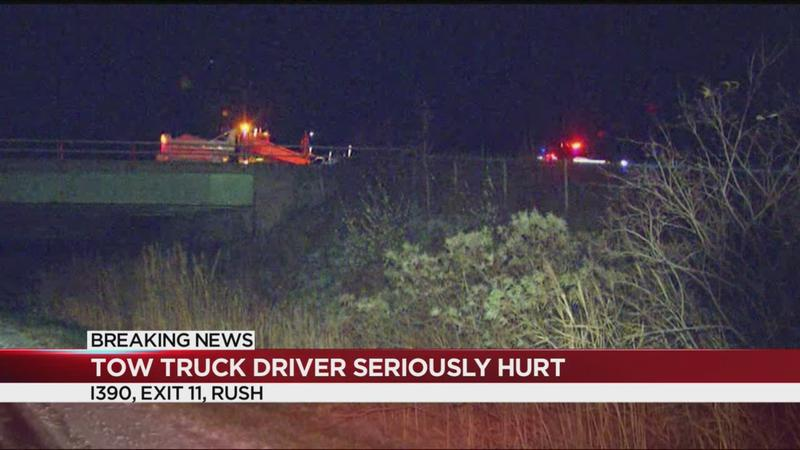 Tow truck driver hit while helping vehicle on 390