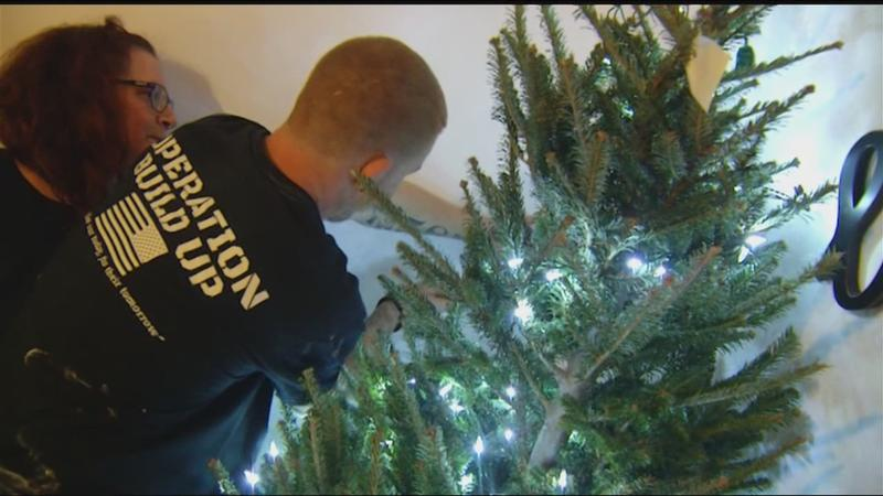 Army of military elves prepare early Christmas surprise for a struggling veteran, family
