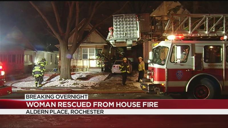 Rochester woman rescued from roof of burning home