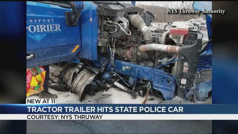 Tractor-trailer hits state police car
