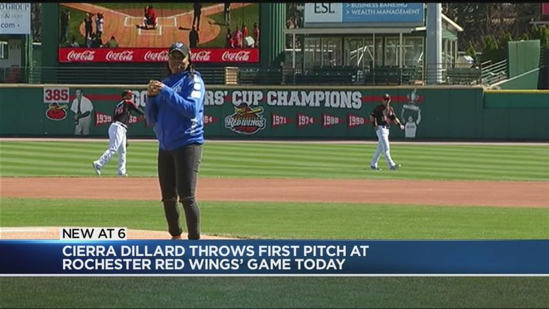 Local basketball star throws out first pitch at Red Wings game