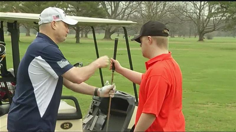 "Police join with local kids to become ""Best Buddies"" on the golf course"