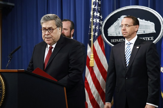 Attorney General William Barr speaks alongside Deputy Attorney General Rod Rosenstein, right, and Deputy Attorney General Ed O'Callaghan, rear left, about the release of a redacted version of special counsel Robert Mueller's report during a news conference, Thursday, April 18, 2019, at the Department of Justice in Washington.