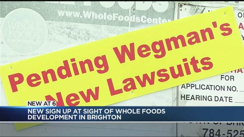 Sign at proposed Whole Foods location takes shot at Wegmans