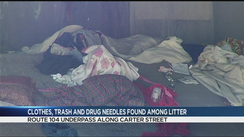 Clothes, trash, drug needles among litter at Route 104 underpass along Carter Street