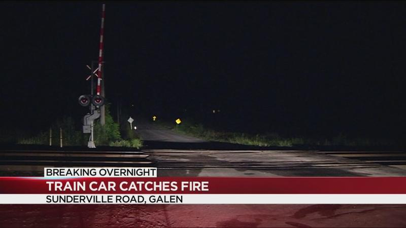 Train car catches fire in Wayne County