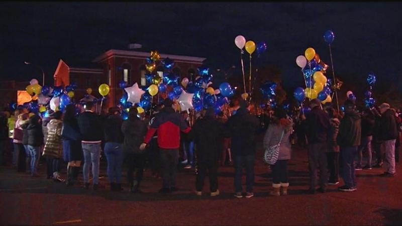 Thomas Jefferson High School alumni prepare to release balloons in memory of Officer Ortiz