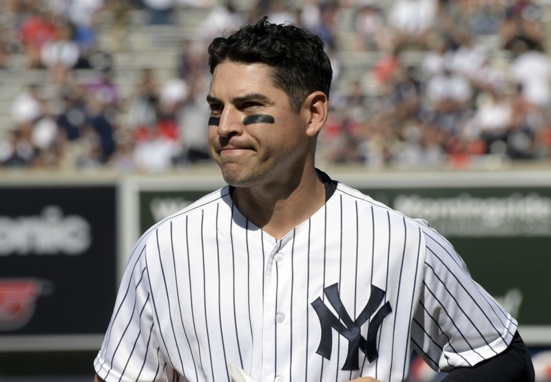 In this Aug. 30, 2017, file photo, New York Yankees' Jacoby Ellsbury reacts after grounding out to end the sixth inning in the first game of the baseball team's doubleheader against the Cleveland Indians at Yankee Stadium in New York. The Yankees have given up on Ellsbury, cutting the oft-injured outfielder with one guaranteed season and more than $26 million left in his $153 million, seven-year contract. (AP Photo/Bill Kostroun, File)