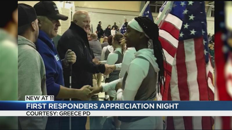 Girls Varsity Basketball team honors Officers Ortiz, Wright at first responders night