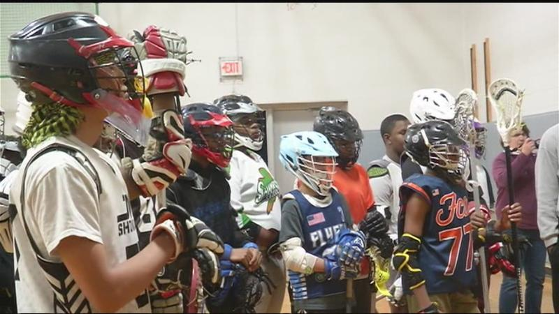 High school lacrosse player donates equipment at School of the Arts