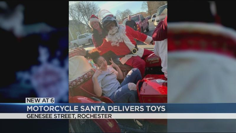 Motorcycle Santa delivers presents at the Boys and Girls Club