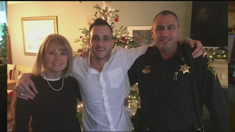 Jeremy Marconi (center) pictured with his mother, Bernadette Marconi (left) and Deputy Michael Favata (right).