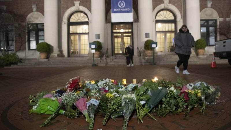 In this Dec. 12, 2019 file photo, a woman walks past a make-shift memorial for Tessa Majors inside the Barnard College campus in New York. Authorities say a 14-year-old was arrested in fatal stabbing of Majors on Saturday, Feb. 15, 2020. Majors was stabbed as she walked through Manhattan's Morningside Park on Dec. 11