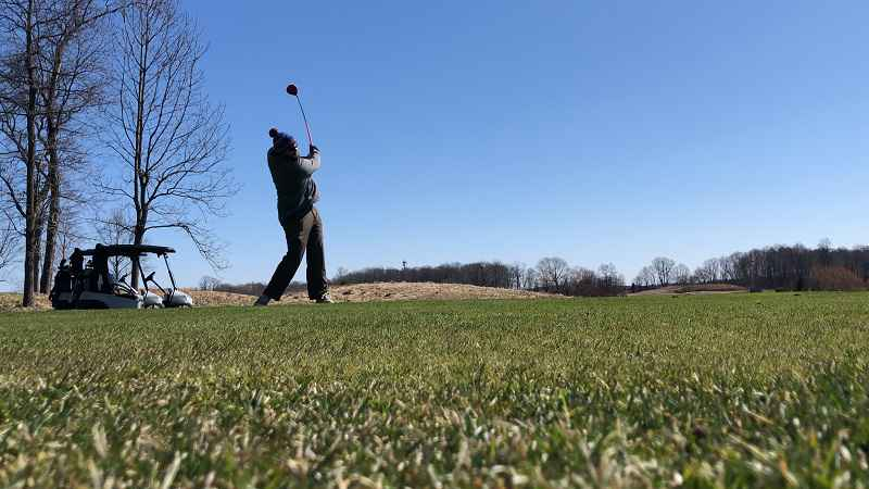 Local golfers keep swinging while practicing social distancing