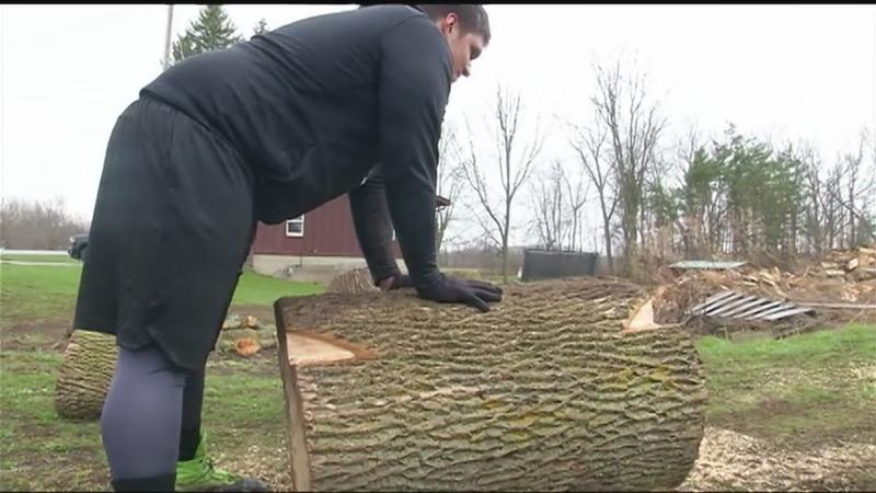 Brothers using logs to stay in shape for football season