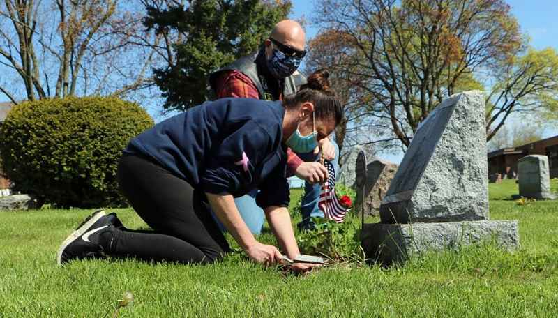 Town of Greece, American Legion plant flowers for veterans at local cemeteries