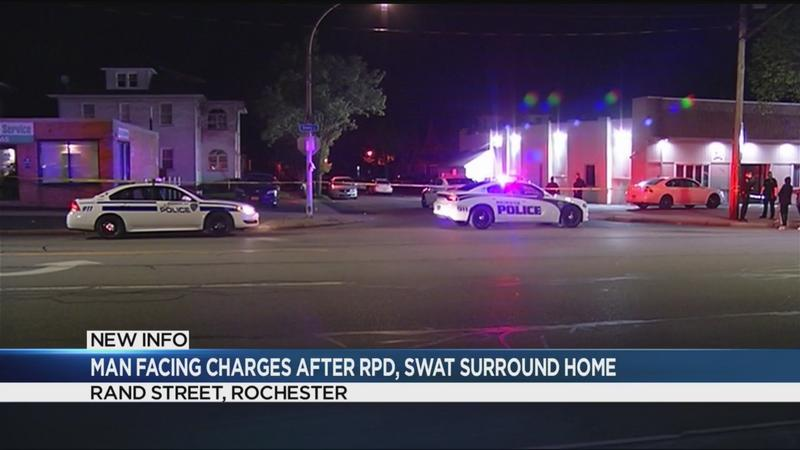 Man facing charges after RPD, SWAT surround home