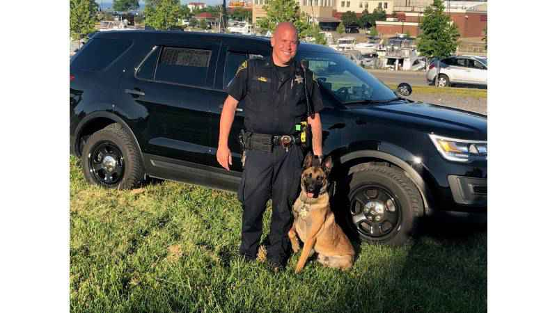 Sgt. Shawn Edwards (left) and K9 Ike (right)
