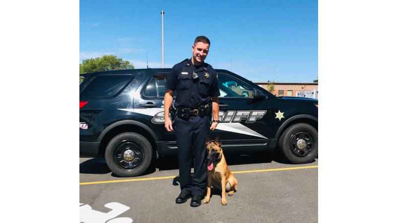 Dep. Jeff Cookinham (left) and K9 Fico (right)