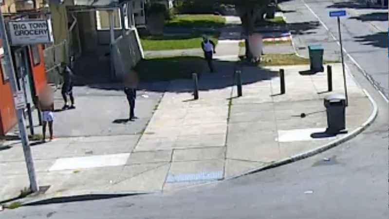 A frame from a video showing two men wanted in connection to an assault on or near Denver Street on Friday.