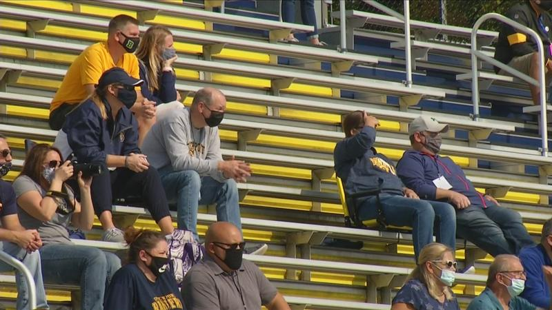 COVID precautions mean unusual sights in stands of high school sports