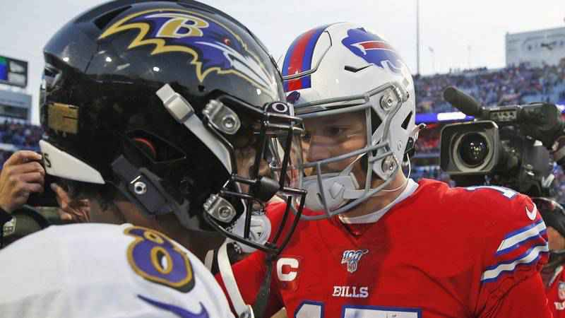 Buffalo Bills quarterback Josh Allen (17) talks with Baltimore Ravens quarterback Lamar Jackson (8) following a 24-17 Ravens win in an NFL football game in Orchard Park, N.Y., in this Sunday, Dec. 8, 2019, file photo. Buffalo's Josh Allen and Baltimore's Lamar Jackson become the first quarterbacks of the five-member 2018 first-round draft class set to meet in the playoffs as the Bills prepare to face the Ravens in the AFC divisional round on Saturday night, Jan. 16, 2021.
