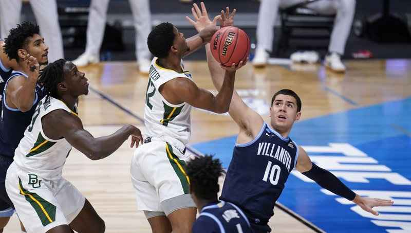 Baylor guard Jared Butler (12) shoots on Villanova forward Cole Swider (10) in the first half of a Sweet 16 game in the NCAA men's college basketball tournament at Hinkle Fieldhouse in Indianapolis, Saturday, March 27, 2021.