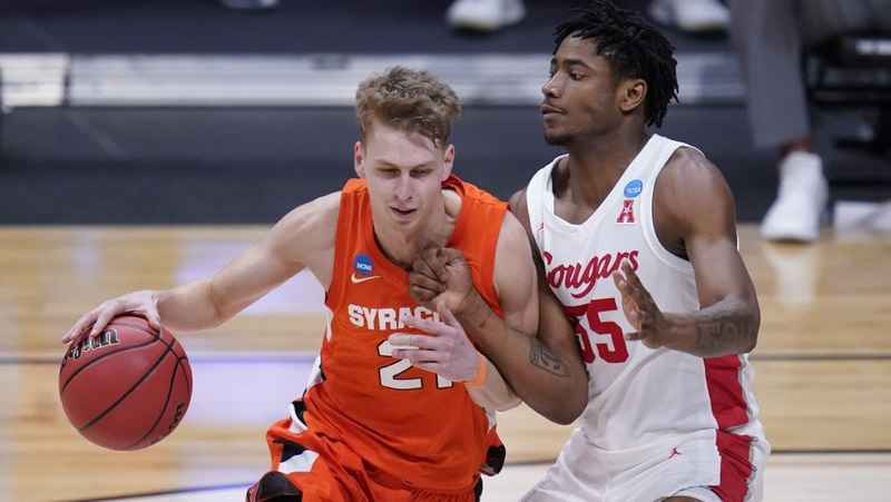 Syracuse forward Marek Dolezaj (21) drives on Houston forward Brison Gresham (55) in the second half of a Sweet 16 game in the NCAA men's college basketball tournament at Hinkle Fieldhouse in Indianapolis, Saturday, March 27, 2021.