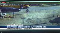 VIDEO: Girl nearly hit by SUV passing stopped school bus