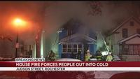 House fire forces people out into the cold