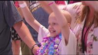 Happy to be home: Young girl returns home to a warm welcome after beating cancer