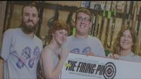 Brandon Lewis (center,) owner of The Firing Pin